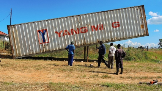 40ft container rests on two telegraph poles