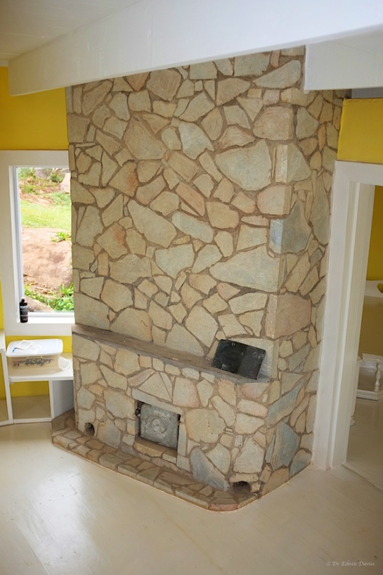 our masonry stove - faced in soap stone
