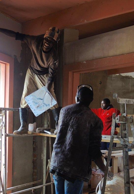 Mr Farai enjoys plastering in Rhinoset