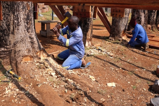 Tendai carving out holes for the long supporter beams