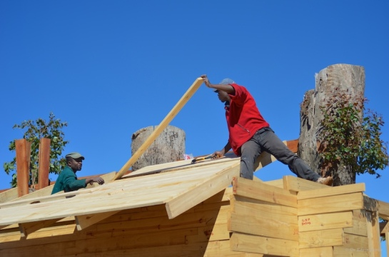Roofers in action