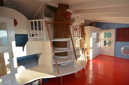 Inside the tree house showing our sweeping staircase up to the bunks