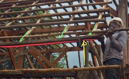 Post and Beam – hammering battens onto cantilevered overhangingrafters